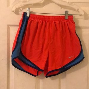 orange nike shorts
